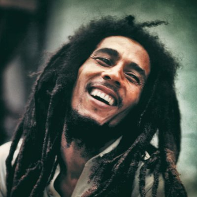 Smiling Bob Marley with his long dreads