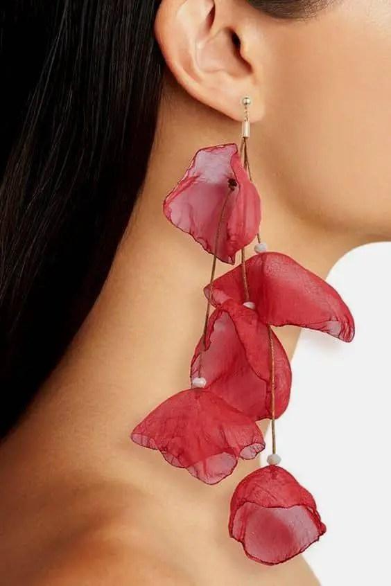 wearing red dangling earrings
