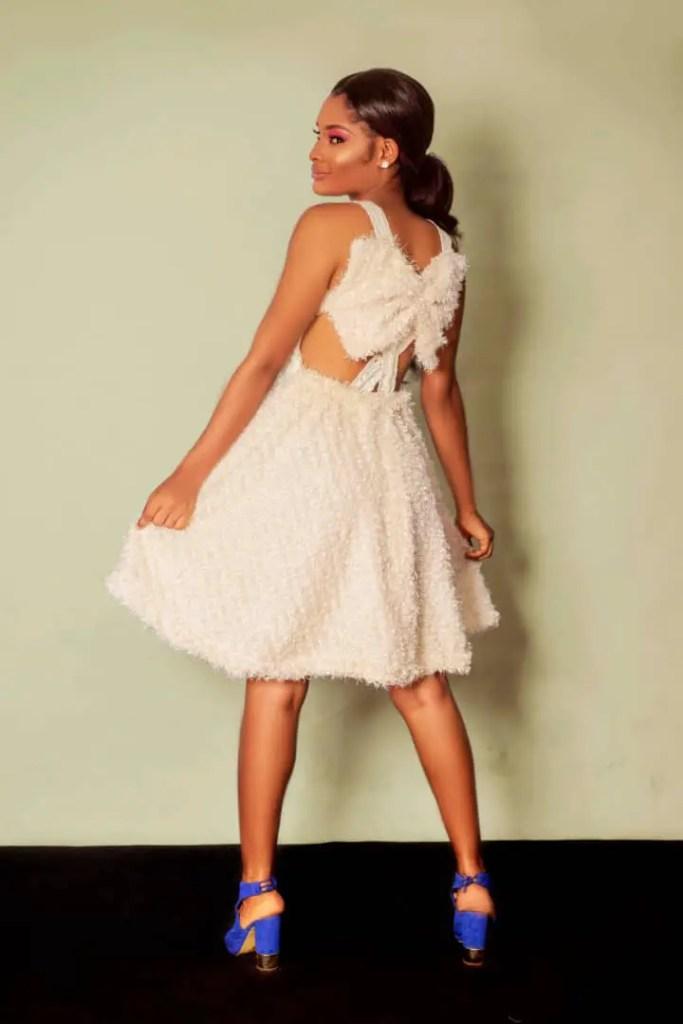 lady wearing statement dress by Ria Kosher