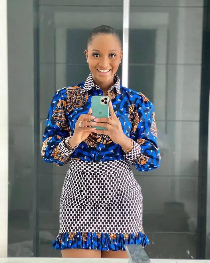 smiling woman wearing mixed ankara shirt and skirt