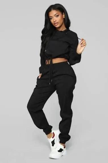 lady wearing black sweat pants