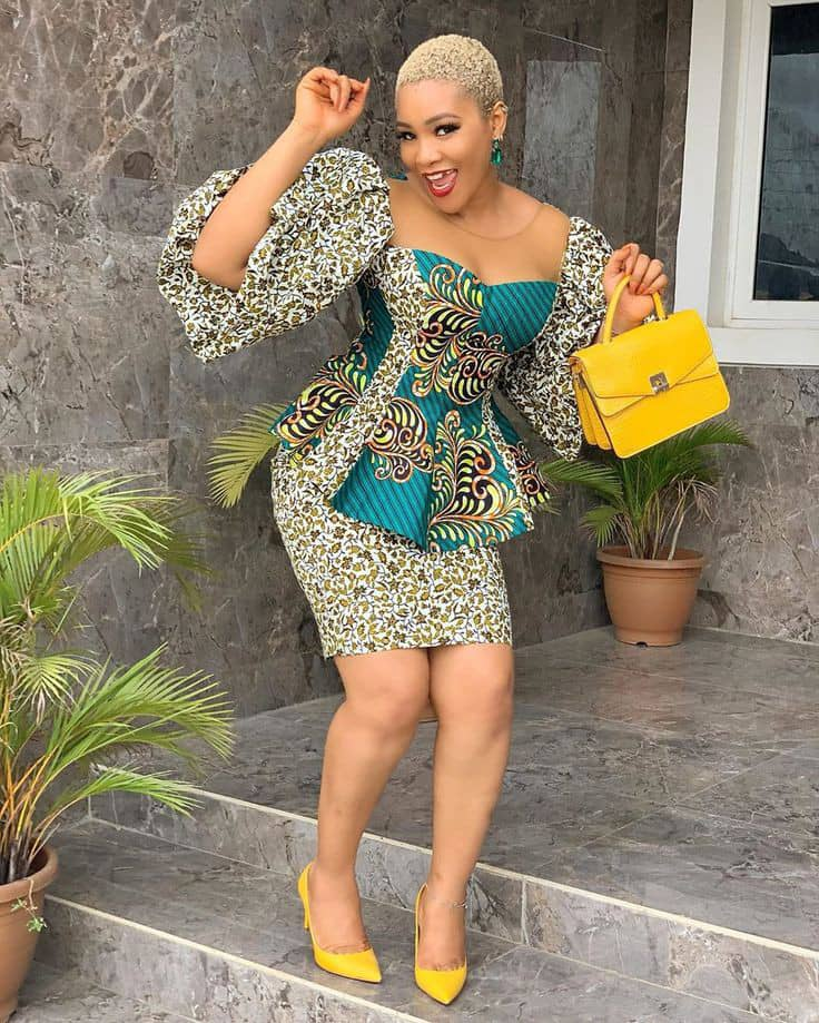 dancing lady in different pattern ankara top and skirt