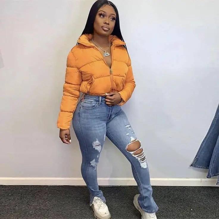lady wearing an orange sweat jacket with jeans