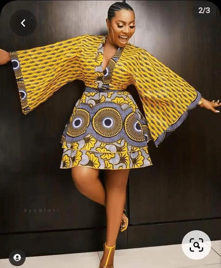 lady wearing related color ankara fabrics