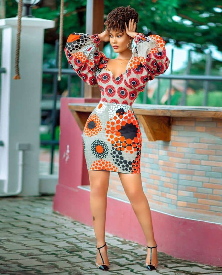 lady wearing different prints ankara outfit