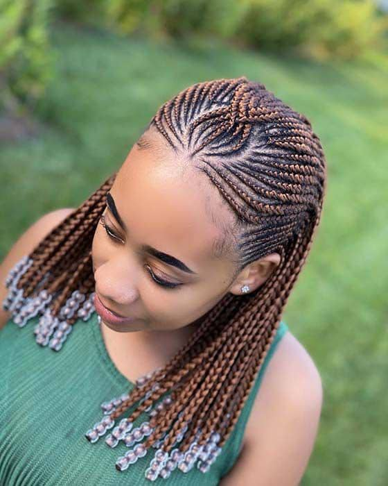 lady wearing brown cornrows with beads