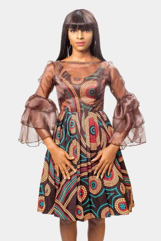 lady wearing ankara and organza dress