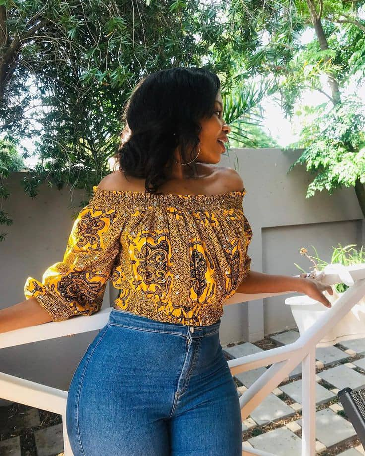 lady wearing ankara top with jeans