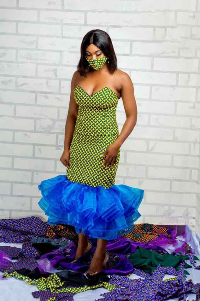lady wearing ankara and organza midi gown