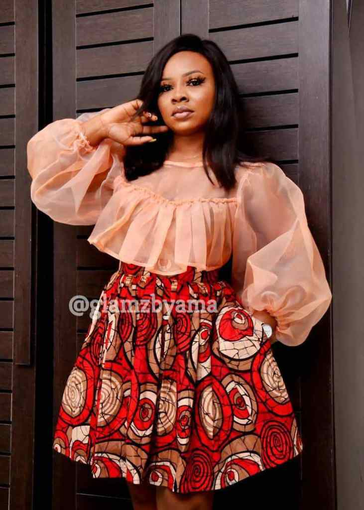lady wearing ankara and organza short gown