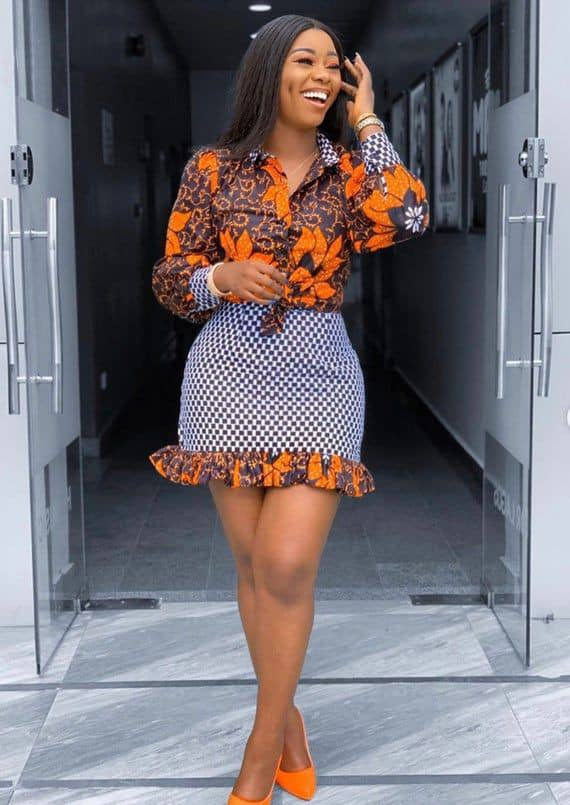 lady wearing ankara shirt and skirt