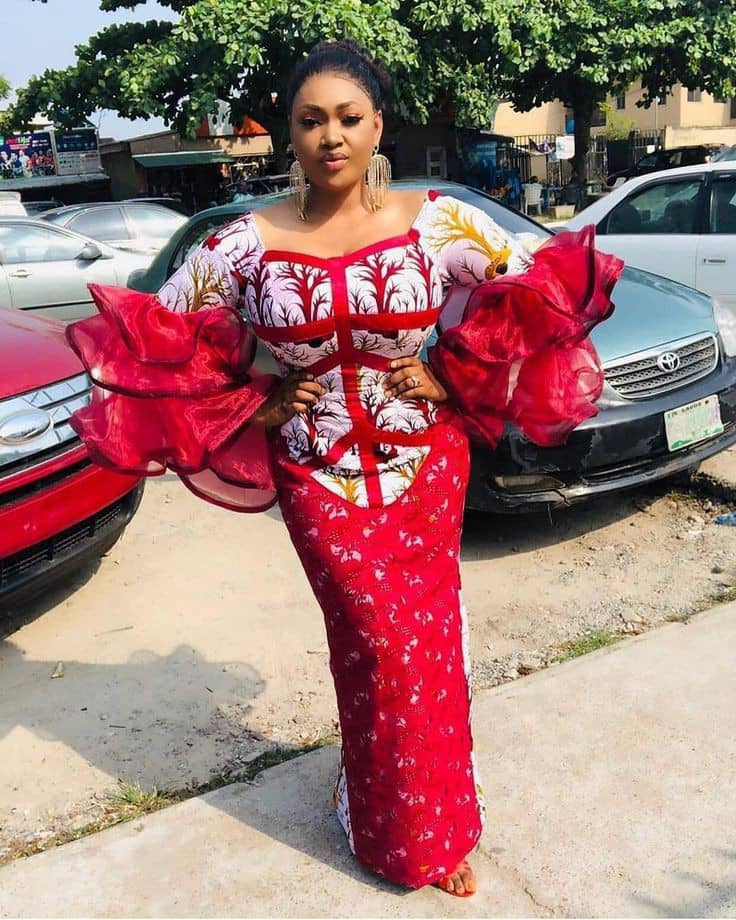 lady wearing ankara and organza long gown