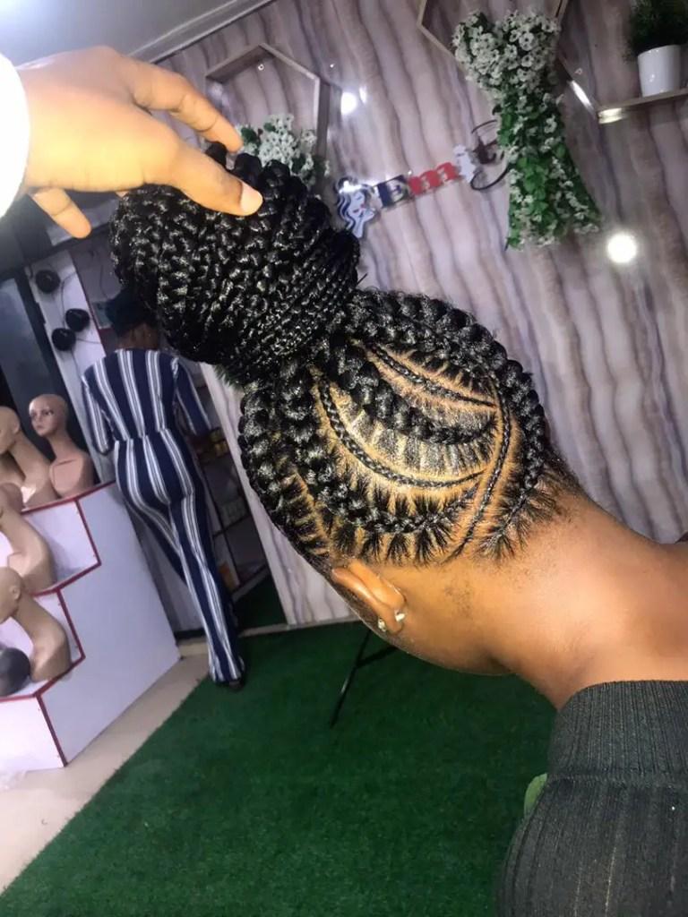 back view of a stitch braids with a single bun