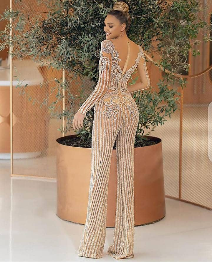 lady wearing jumpsuit made with lace material