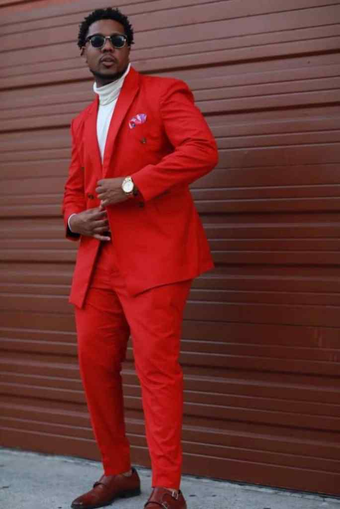 guy wearing red suit to a wedding