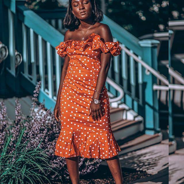 black lady wearing polka dots dress