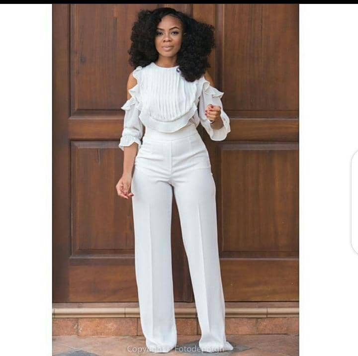 lady wearing white jumpsuit
