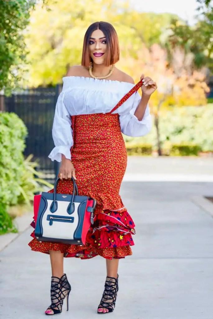 lady rocking ankara skirt with white top