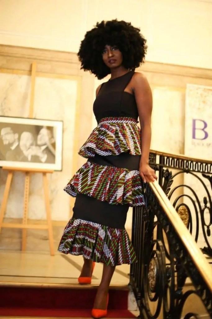 lady wearing black top with midi ankara skirt