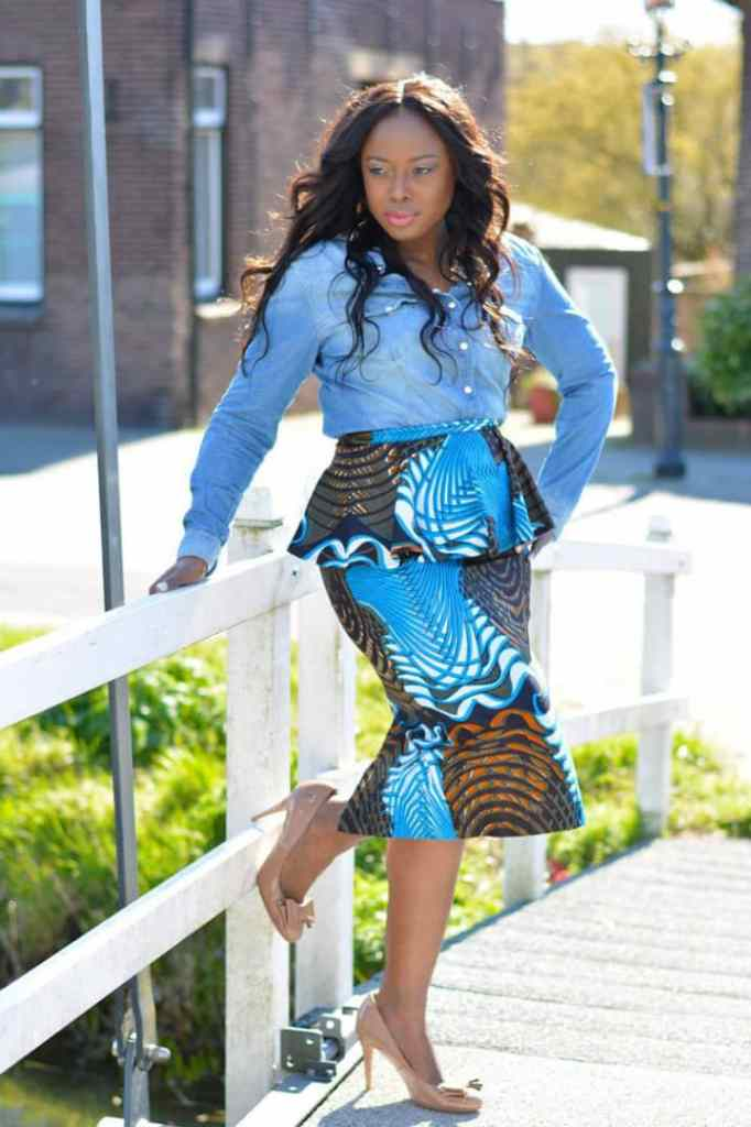 lady wearing peplum ankara top with matching skirt