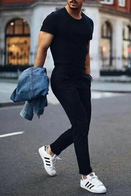man rocking white sports shoes