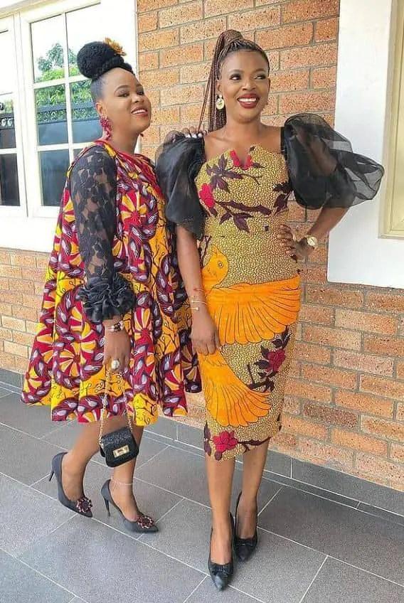 two ladies rocking ankara owambe dresses
