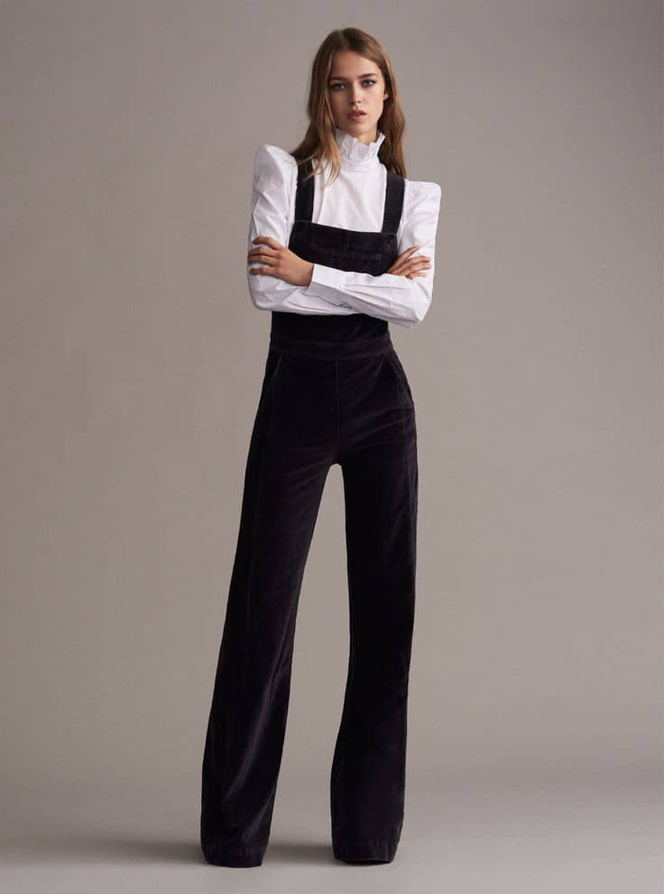 lady wearing with shirt paired with black long dungaree