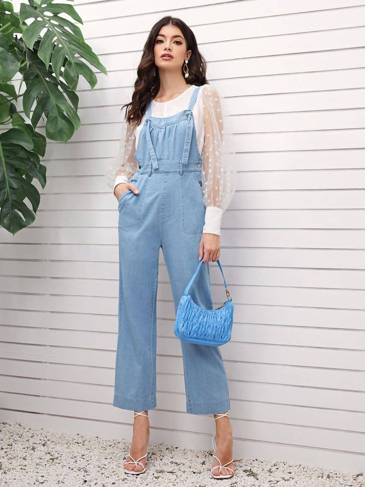 lady wearing blue dungaree with white shirt