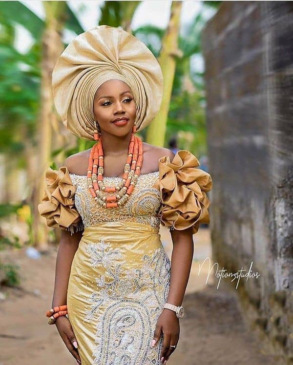 pretty lady dressed as bride at a wedding owambe