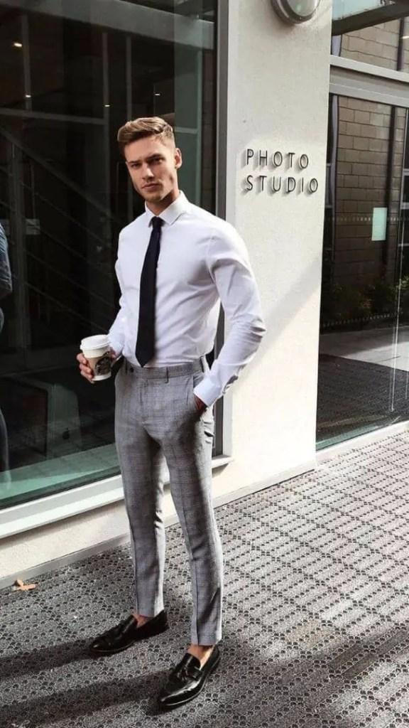 man in a formal office wear taking a break with a coffee