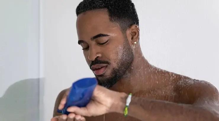 man applying moisturizer on hair