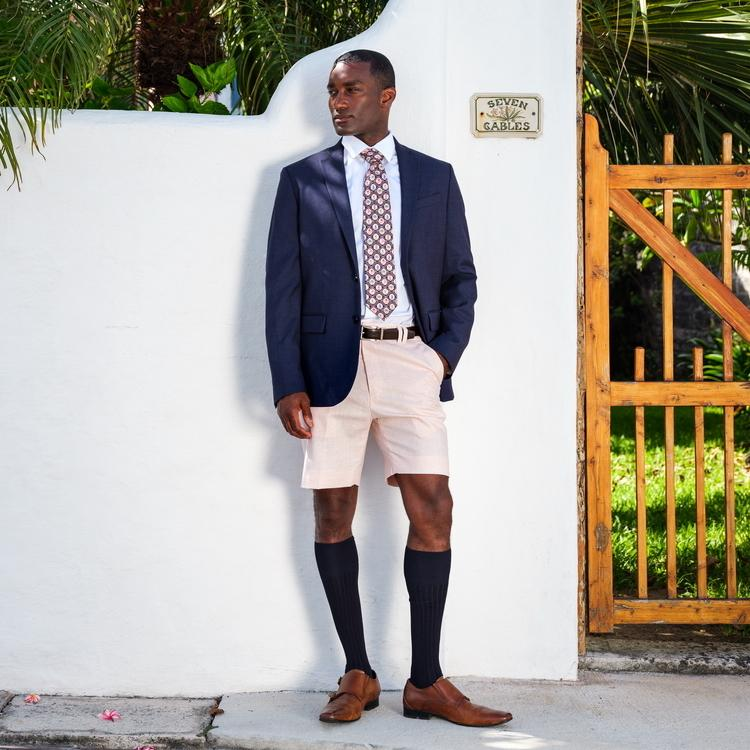 man wearing suit and tie on shorts