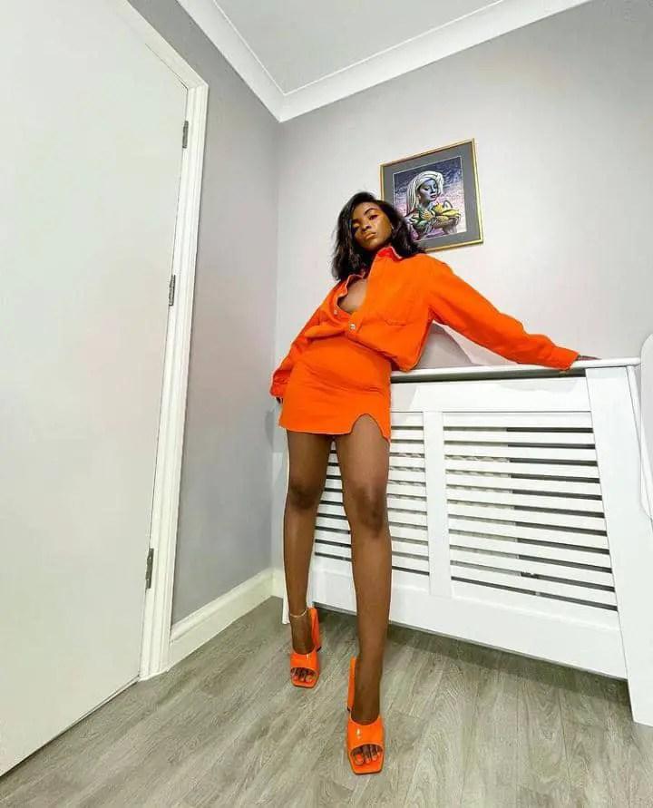 lady rocking orange matching set top and mini skirt