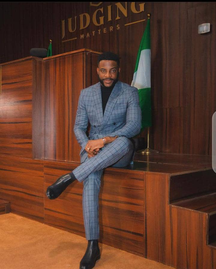 Ebuka wearing formal office wear at the court