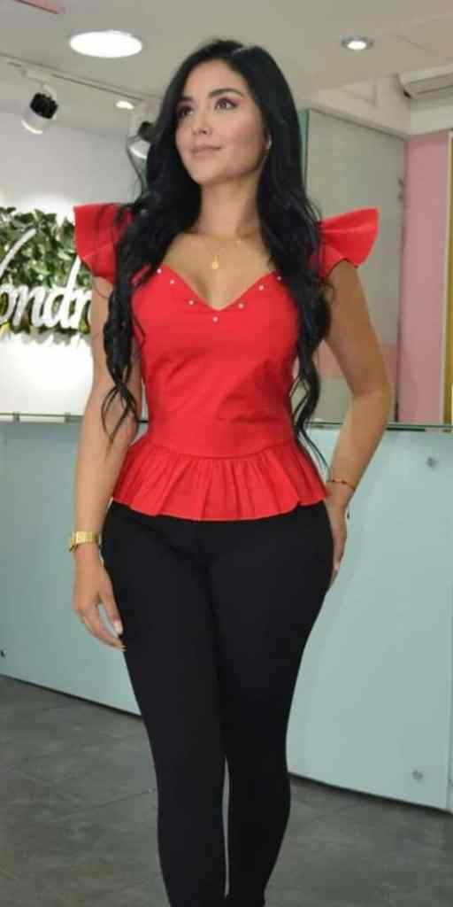 lady wearing v-neck red top with black pants