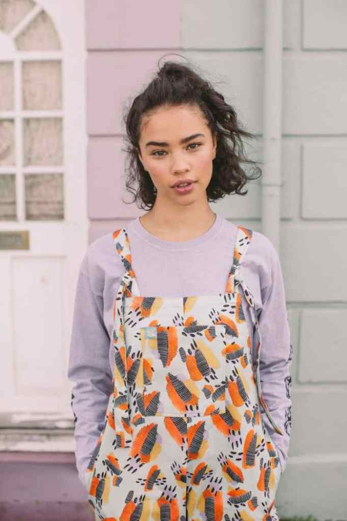 lady wearing long sleeves t-shirt with dungaree