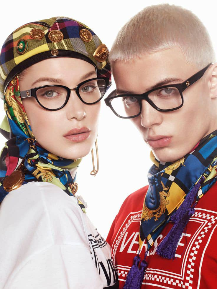 man and woman wearing glasses and neck scarf