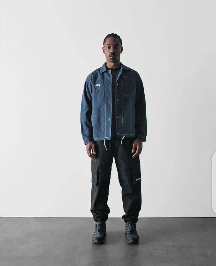 black man wearing streetwear outfit