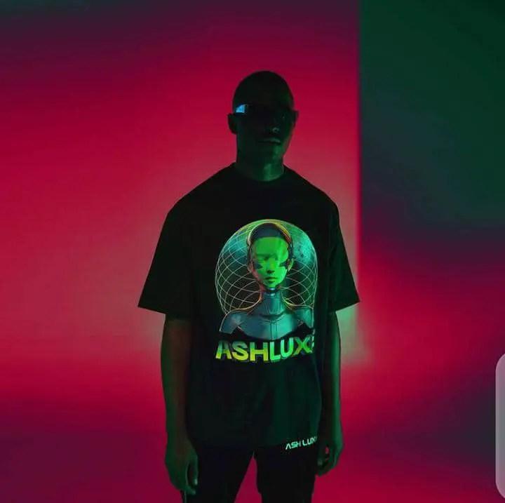 man in black Ashluxe t-shirt