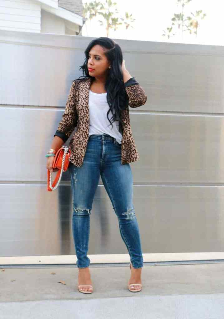 lady wearing jacket on jean and white top