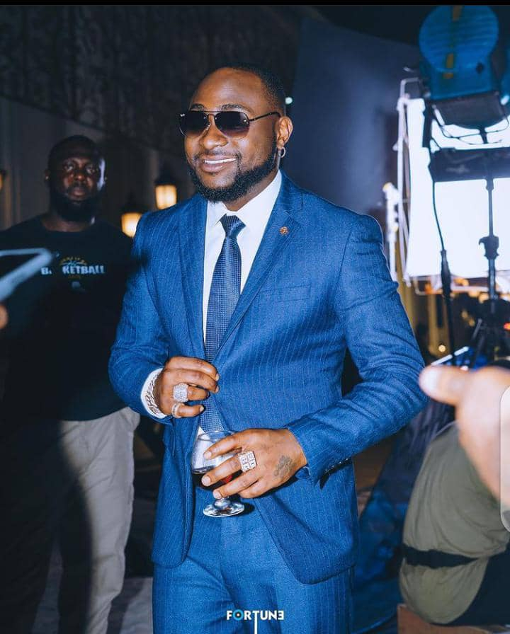 Davido wearing blue suit with glasses for Fortune