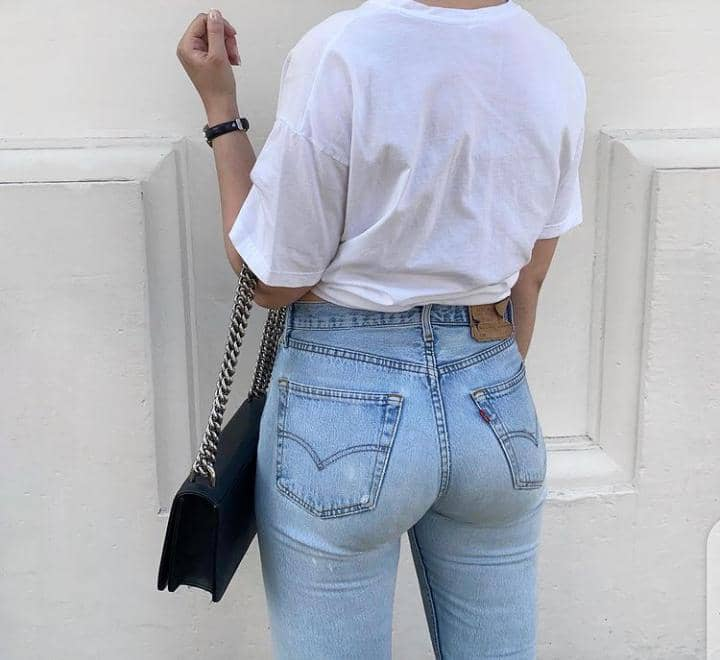 lady wearing white T-shirt and jeans