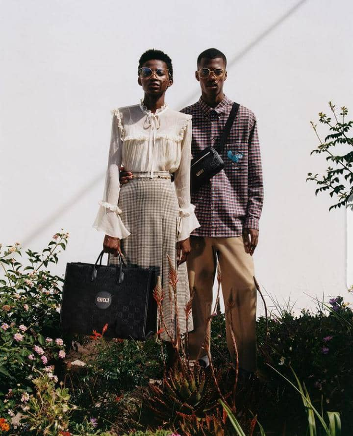 man and woman wearing Gucci clothes with bags