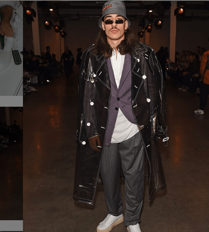 Hector Bellerin donning a long jacket