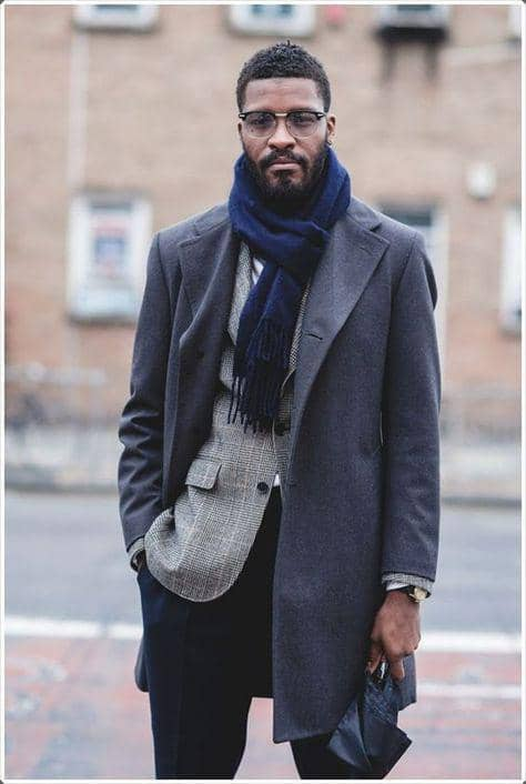 man layering with scarf