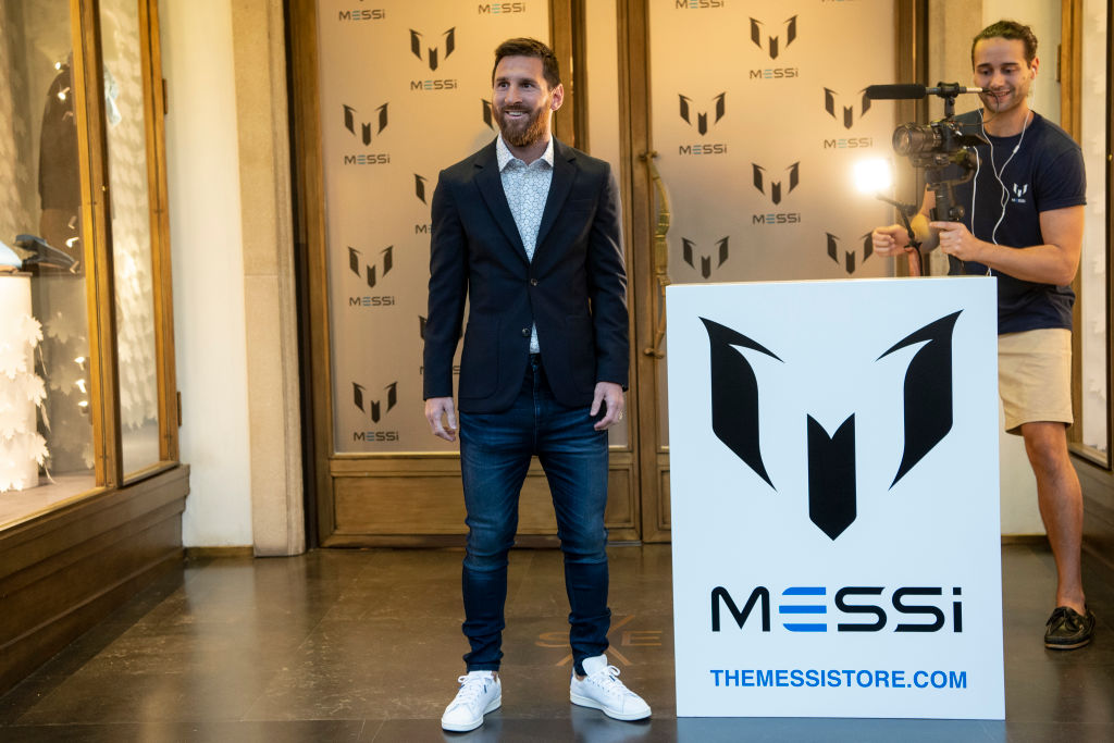 Messi wearing suit and jeans and white sneakers