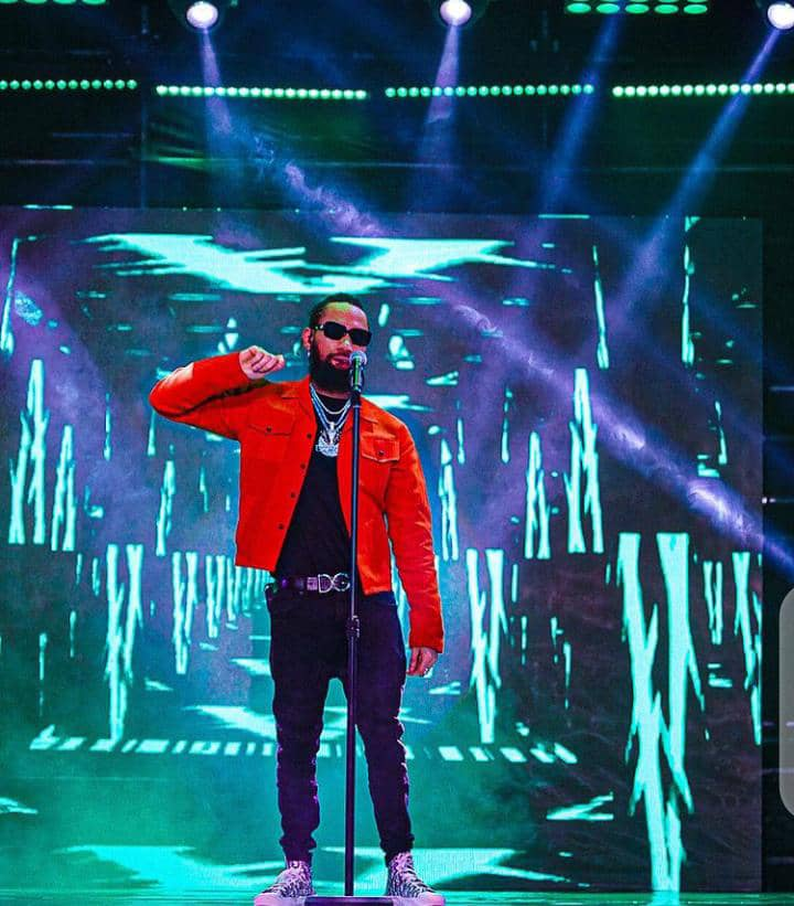 Phyno performing in red jacket and black pants