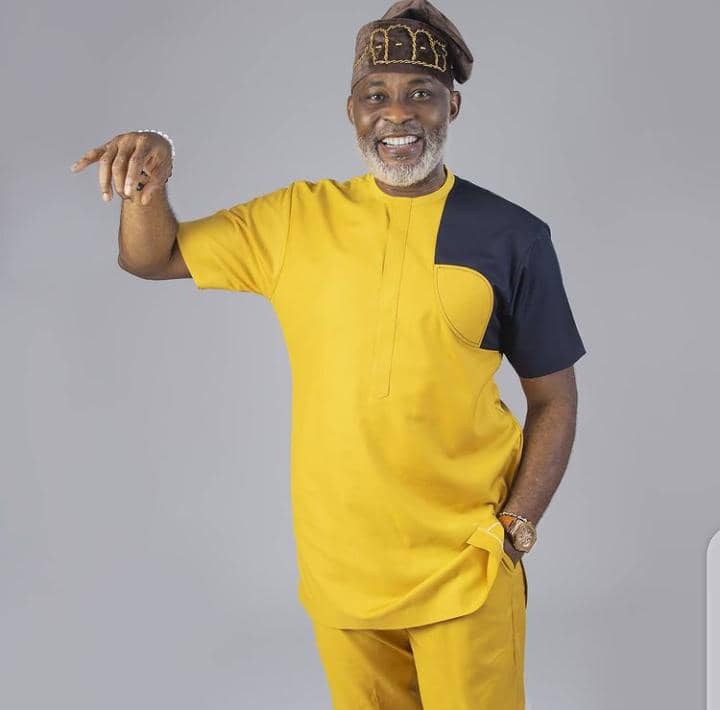 RMD wearing yellow and black senator outfit with cap