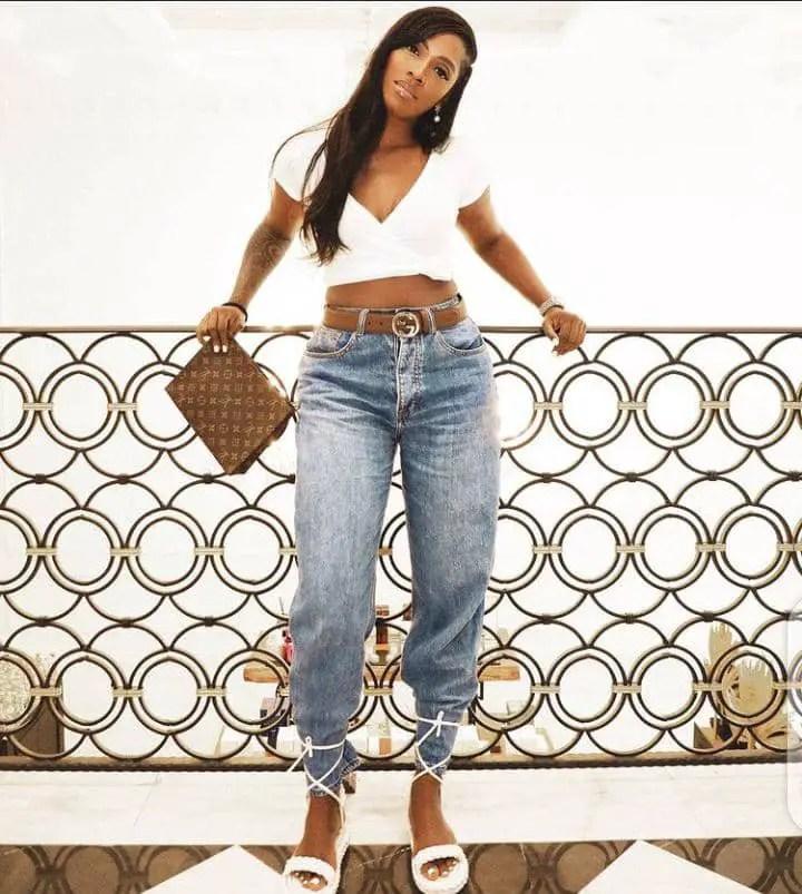 Tiwa Savage rocking white crop top and jeans