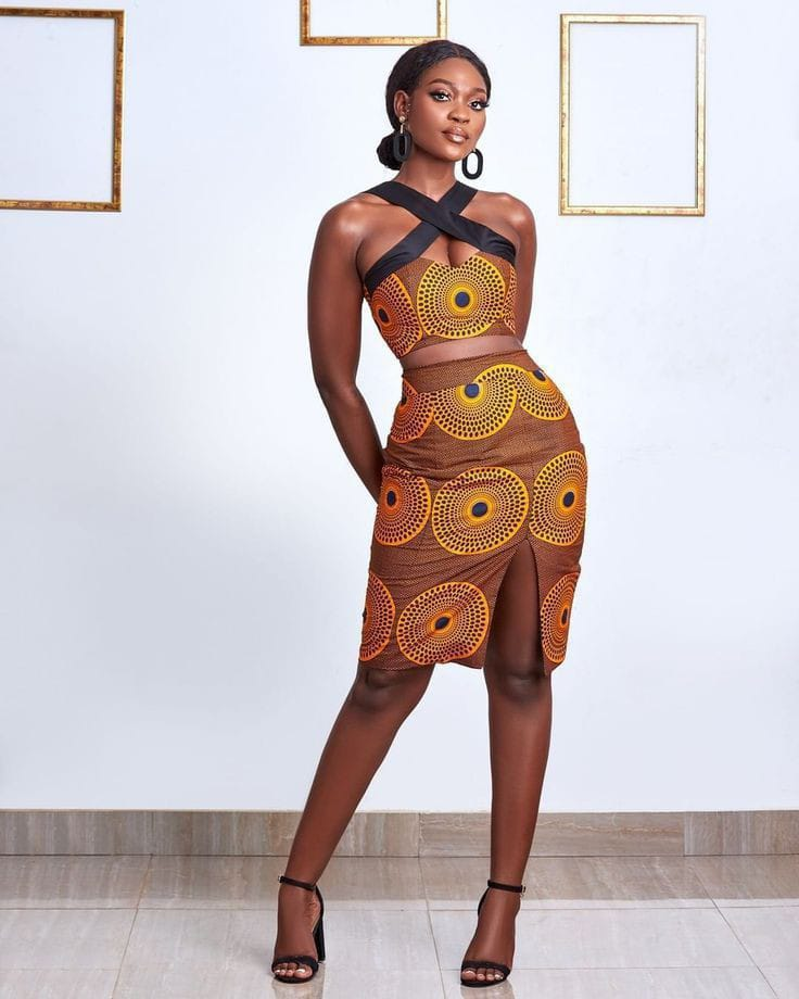 lady posing in ankara top with matching skirt